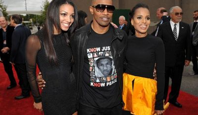 "Actor Jamie Foxx (center); Corrine Bishop (left), his daughter; and Kerry Washington, his ""Django Unchained"" co-star, arrive at the MTV Movie Awards at the Sony Pictures lot in Culver City, Calif., on Sunday, April 14, 2013. (John Shearer/Invision for MTV/AP Images)"