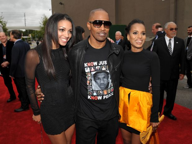 """Actor Jamie Foxx (center); Corrine Bishop (left), his daughter; and Kerry Washington, his """"Django Unchained"""" co-star, arrive at the MTV Movie Awards at the Sony Pictures lot in Culver City, Calif., on Sunday, April 14, 2013. (John Shearer/Invision for MTV/AP Images)"""