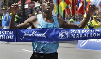 Lelisa Desisa of Ethiopia crosses the finish line to win the men's division of the 2013 Boston Marathon in Boston Monday, April 15, 2013. (AP Photo/Elise Amendola)