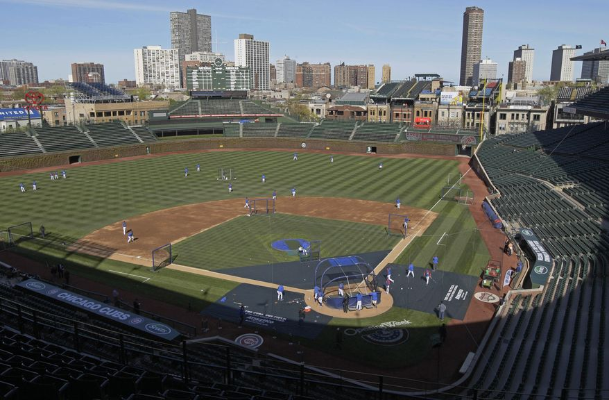 FILE - In this April 4, 2012 file photo, Chicago Cubs players work out at Wrigley Field in Chicago, the day before their home-opener baseball game. Two people with knowledge of the negotiations between the Ricketts family that owns the Cubs and the city say the two are near an agreement on a $500 million project at Wrigley Field. The people spoke Friday, April 5, 2013, on condition of anonymity because the deal was not yet finished and they are not authorized to publicly discuss it. The deal calls for $300 million in renovations at Wrigley and a $200 million hotel nearby. (AP Photo/Nam Y. Huh, File)