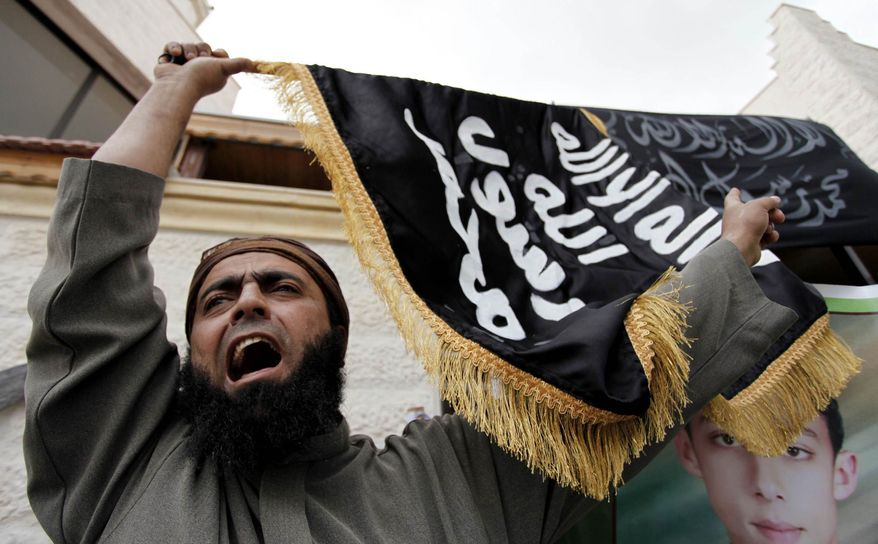 ** FILE ** A Jordanian supporter of the Salafi Jihadi group chants slogans, during a protest against the prolonged detention of the group's leaders in Jordanian jails, in Amman, Jordan, Tuesday, April 9, 2013. (AP Photo/Mohammad Hannon)