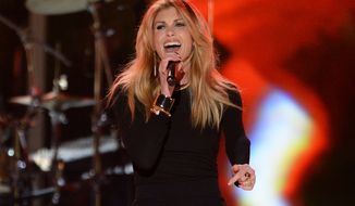 "**FILE** Country star Faith Hill performs at ""ACM Presents: Tim McGraw's Superstar Summer Night"" at the MGM Grand Garden Arena in Las Vegas on April 8, 2013. (Associated Press/Invision)"