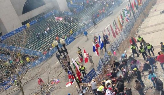 Photo of the aftermath of a suspected explosion at the finish line of the Boston Marathon. (Twitter photo/Tyler Wakstein)