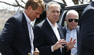 **FILE** Republican Sens. John McCain (right) and Jeff Flake (left), both of Arizona, listen as Sen. Chuck Schumer, New York Democrat, talks prior to a news conference after their tour of the Mexico border with the United States on March 27, 2013, in Nogales, Ariz. (Associated Press)