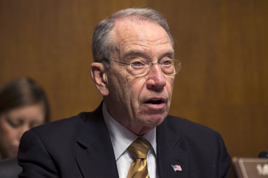 **FILE** Sen. Chuck Grassley, Iowa Republican, speaks during a Senate Judiciary Committee hearing on immigrant women and immigration reform on Capitol Hill in Washington on March 18, 2013. (Associated Press)