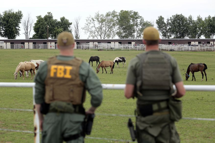 FBI agents check out a horse ranch under investigation in Lexington, Okla., in June 2012. Prosecutors in Texas say Jose Trevino Morales, the brother of two top leaders of Los Zetas, a Mexican drug cartel, oversaw the purchase of hundreds of horses at the ranch in Oklahoma in a scheme to launder drug money. (AP Photo/Brett Deering)