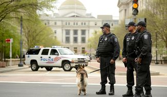 **FILE** Police keep watch along Pennsylvania Ave. (Andrew Harnik/The Washington Times)