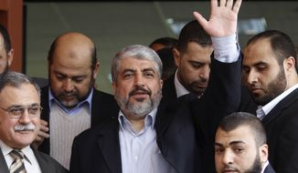 ** FILE ** In this Dec. 9, 2012, file photo, Hamas leader Khaled Mashaal waves during his visit to the Islamic University in Gaza City. (AP Photo/Hatem Moussa, File)