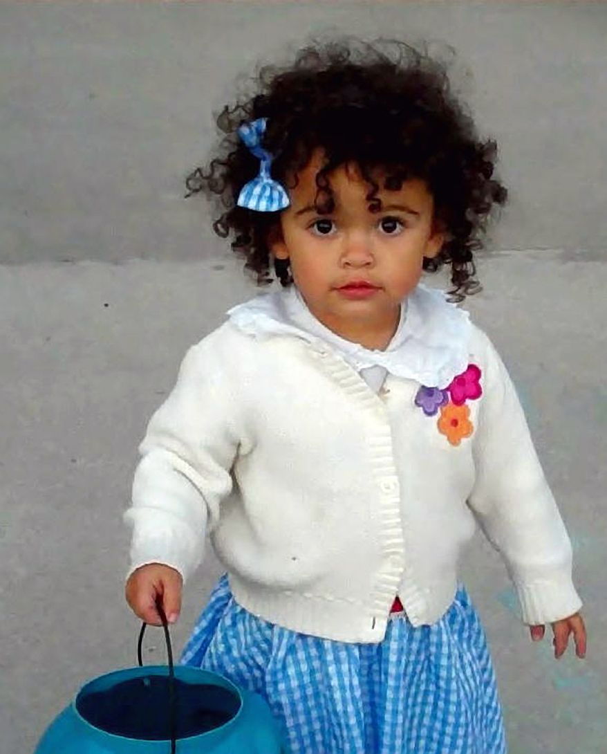 Matt and Melanie Capobianco's adoptive daughter, Veronica, goes trick-or-treating in Charleston, S.C., in October 2011. The girl is at the center of a case before the U.S. Supreme Court challenging a federal law on the adoption of American Indian children. (AP Photo/Courtesy of Melanie Capobianco)