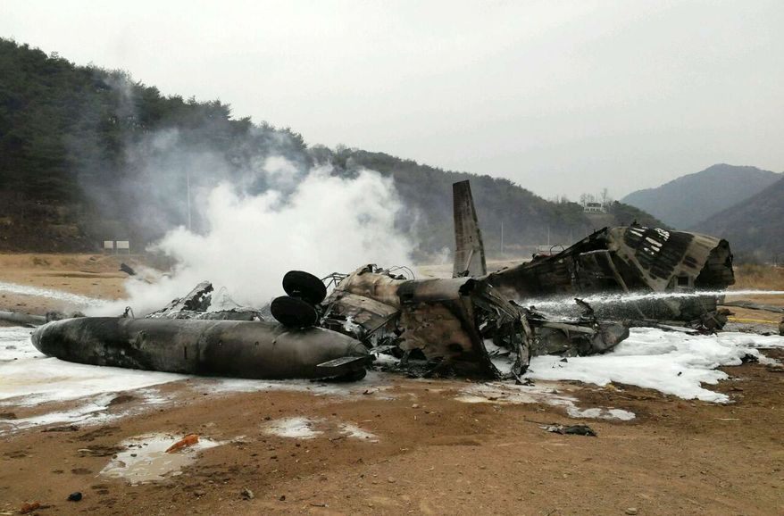"The wreckage of a U.S. Marine helicopter CH-53E Super Stallion helicopter smolders after it made a ""hard landing"" during an exercise called SsangYong, a Korean Marine Exchange Program and part of the Foal Eagle exercise in Chulwon, north of Seoul, South Korea, Tuesday, April 16, 2013. Twenty-one personnel were on board the helicopter, including five crew members, according to a statement from United States Forces Korea. All were taken to the hospital, but 15 were quickly released. The remaining six were in stable condition. (AP Photo/Yonhap) KOREA OUT"