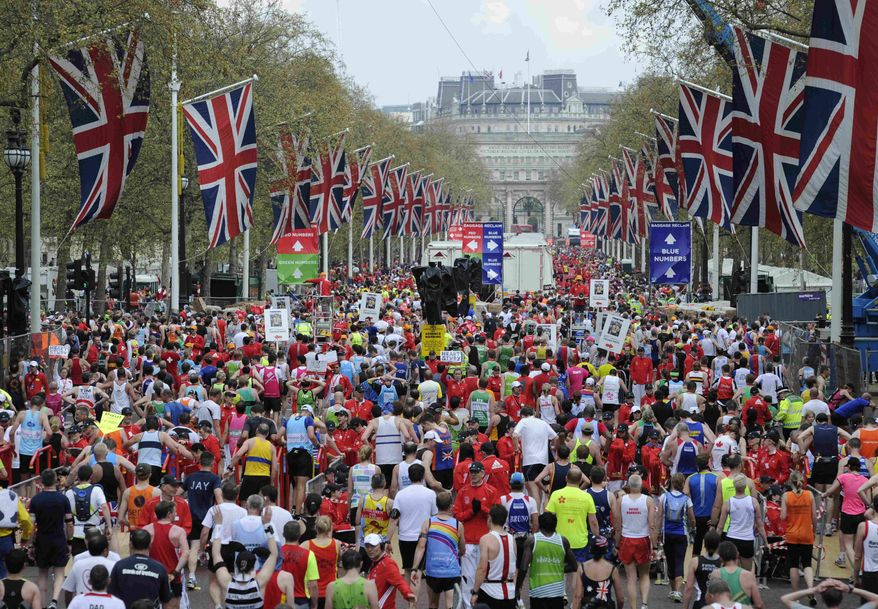 "FILE - In this April 25, 2010 file photo, competitors make their way from the finish area at the London Marathon. Determined to put on a show of ""solidarity"" for Boston, London Marathon organizers will stage the race on Sunday, April 21, 2013. The British capital has long been a top target for terrorists, and these concerns have only intensified after harrowing scenes from the Boston Marathon on Monday, April 15, 2013,where bombs killed three people and injured more than 170. (AP Photo/Tom Hevezi, File)"