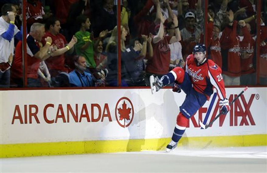 Washington Capitals right wing Troy Brouwer (20) celebrates his goal in the second period of an NHL hockey game against the Toronto Maple Leafs Tuesday, April 16, 2013 in Washington. (AP Photo/Alex Brandon)