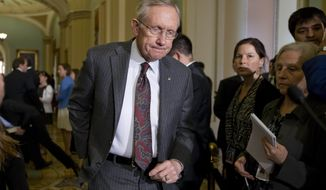 ** FILE ** Senate Majority Leader Harry Reid, Nevada Democrat, arrives to speak with reporters following a Democratic strategy session at the Capitol in Washington on Tuesday, April 9, 2013. (AP Photo/J. Scott Applewhite)