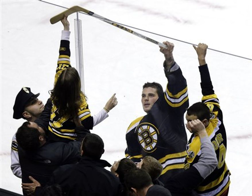 Boston Bruins center Tyler Seguin gives his stick to a fan after they defeated the Ottawa Senators 3-2 in an NHL hockey game in Boston, Tuesday, April 2, 2013. The teams' game April 15 was postponed after bombings at the Boston Marathon. (Associated Press)