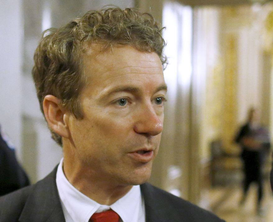 ** FILE ** In this March 7, 2013, file photo, Sen. Rand Paul, Kentucky Republican, talks to reporters on Capitol Hill in Washington. Paul says he is considering a presidential campaign in 2016 but will not make a decision before next year. (AP Photo/Charles Dharapak, File)