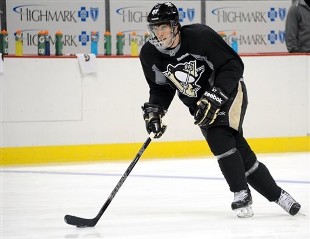 Pittsburgh Penguins hockey player Sidney Crosby skates at the Consol Energy Center in Pittsburgh Monday, April 15, 2013. (AP Photo/Tribune Review, Chaz Palla)