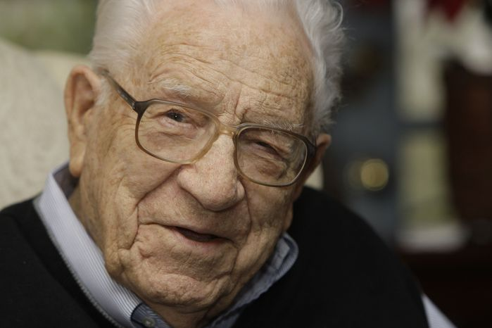 ** FILE ** In this Jan. 13, 2009, file photo, George Beverly Shea talks at his home in Montreat, N.C. Shea, the booming baritone who sang to millions of Christians at evangelist Billy Graham's crusades, died Tuesday, April 16, 2013, after a brief illness. He was 104. (AP Photo/Chuck Burton, File)