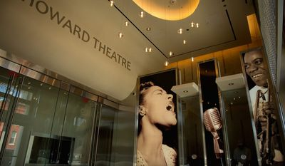 A photograph of Billie Holiday now graces the lobby of the redesigned Howard Theatre, which celebrates its first anniversary Friday with a gala hosted by D.L. Hughley (below).