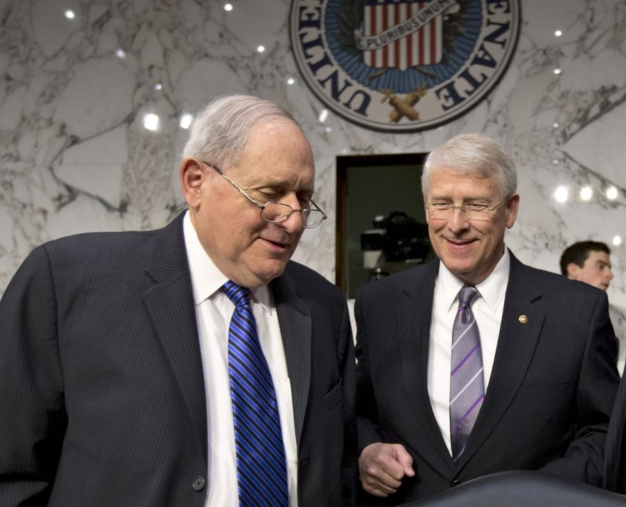 Senate Armed Services Committee Chairman Carl Levin (left), Michigan Democrat, and Sen. Roger Wicker, Mississippi Republican, talk on Capitol Hill in Washington on April 17, 2013, before a hearing with Defense Secretary Chuck Hagel. A letter addressed to Wicker, believed to be poisoned with ricin or a similarly toxic substance, was intercepted at a mail facility outside the capital earlier in the week. Levin issued a statement saying an aide in his Saginaw, Mich., office had also received a suspicious-looking letter. (Associated Press)