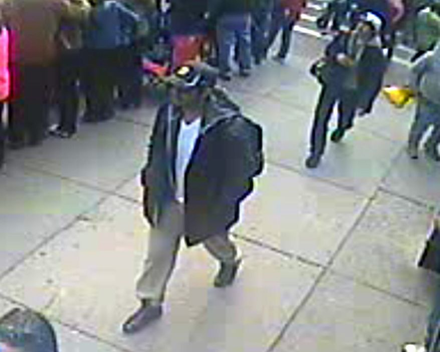 This image released by the FBI on Thursday, April 18, 2013, shows in a image from video what the FBI are calling suspect number 1, front, in black cap, and suspect number 2, in white cap, back right, walking near each other through the crowd in Boston on Monday, April 15, 2013, before the explosions at the Boston Marathon. (AP Photo/FBI)