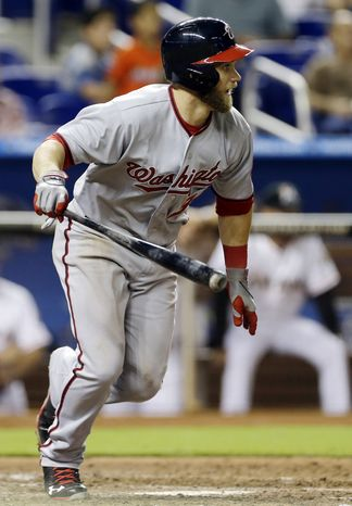 Bryce Harper battled a stomach virus Wednesday night and was still 4-for-5 in the Washington Nationals win over the Miami Marlins. (Associated Press photo)