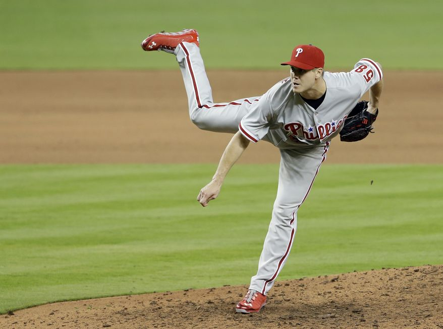 Philadelphia Phillies relief pitcher Jonathan Papelbon pitches to the Miami Marlins during a baseball game in Miami on Sunday, April 14, 2013. The Phillies won 2-1. (AP Photo/Alan Diaz)