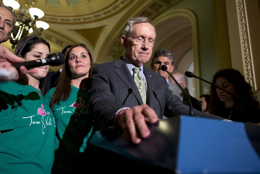Senate Majority Leader Harry Reid, D-Nev., pauses before speaking after losing a vote on gun legislation on Capitol Hill on Wednesday, April 17, 2013, in Washington. (AP Photo/Evan Vucci)