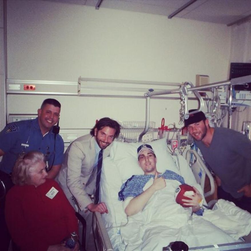 Boston Marathon bombing victim Jeff Bauman was visited in the hospital by actor Bradley Cooper and New England Patriots receiver Julian Edelman. Bauman, despite losing both legs in the blast, provided key details that helped the FBI identify the attackers. (Credt: Edelman's Twitter feed)