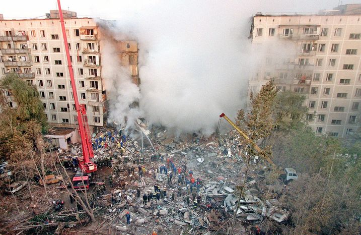 ** FILE ** In this Sept. 9, 1999, file photo, fire and smoke rise from a destroyed apartment building in Moscow during an attack blamed on Chechen militants, as Russian Emergency Situations Ministry officers and firefighters try to save people. (AP Photo/Tatiana Makeyeva, file)