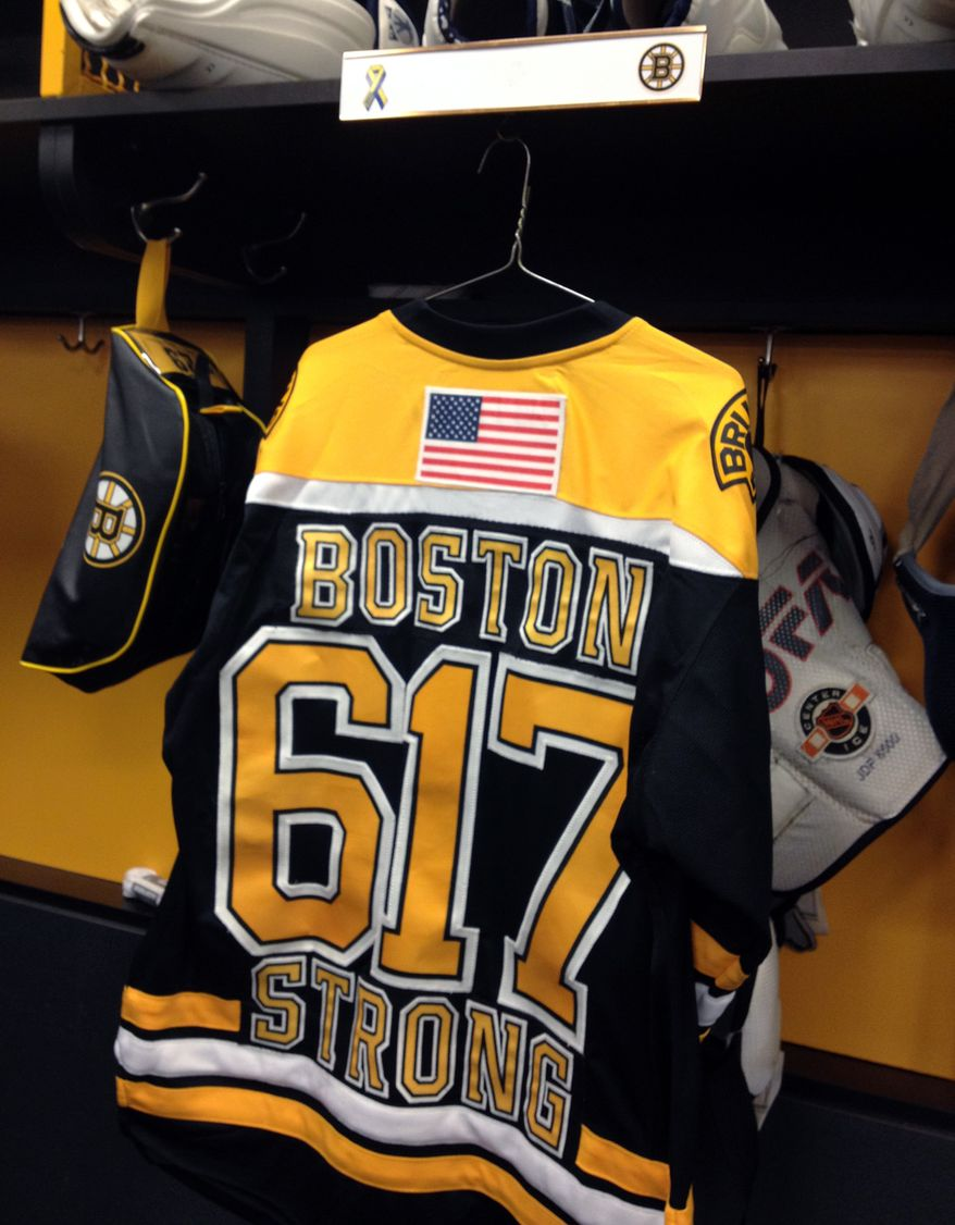 "A Boston Bruins jersey with the number of Boston's area code and the words ""Boston Strong"" hangs in the locker of Bruins player Jay Pandolfo at TD Garden in Boston, Wednesday, April 17, 2013, after an NHL hockey game against the Buffalo Sabres in the aftermath of Monday's Boston Marathon bombings. (AP Photo/Jimmy Golen)"