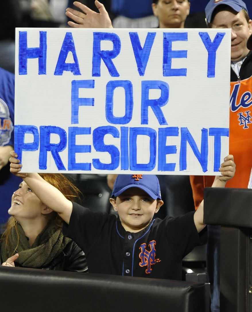 A fan holds up a sign touting Mets right-hander Matt Harvey for president. In a meeting of aces, Harvey and the Mets beat Stephen Strasburg and the Nationals on Friday night. (Associated Press photo)