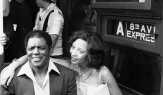 File- This Aug. 2, 1079 file photo shows baseball great Willie Mays and his wife, Mae sitting together on the A train in New York City. Mays announced his wife's death through the San Francisco Giants on Friday April 9, 2013. The couple had been married 41 years after they met during his playing years in New York. The team said Mrs. Mays died in her sleep Friday morning in the couple's Bay Area home after a long fight with Alzheimer's disease. (AP Photo/Marty Lederhandler, File)