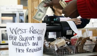 A bucket for placing money for support of residents and first responders is seen here at the Little Czech Bakery in West, Texas, on April 19, 2013. The bodies of 12 people have been recovered after an enormous Texas fertilizer plant explosion that demolished surrounding neighborhoods for blocks and left about 200 other people injured, authorities said Friday. (Associated Press)