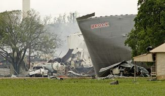 Mangled metal and crushed vehicles are all that remains at the blast site of the fertilizer company, Thursday, April 18, 2013, in West Texas. (AP Photo/The Fort Worth Star-Telegram, Paul Moseley)