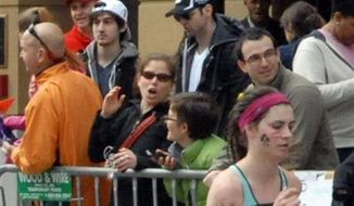 ** FILE ** Runner Bob Leonard captured pictures of the Boston Marathon bombing suspects on April 15, 2013, in Boston. Tamerlan Tsarnaev (third from left), who was dubbed Suspect No. 1, and his brother, Dzhokhar  Tsarnaev, who was dubbed Suspect No. 2 by law enforcement, are pictured approximately 10 to 20 minutes before the blasts. (AP Photo/Bob Leonard)