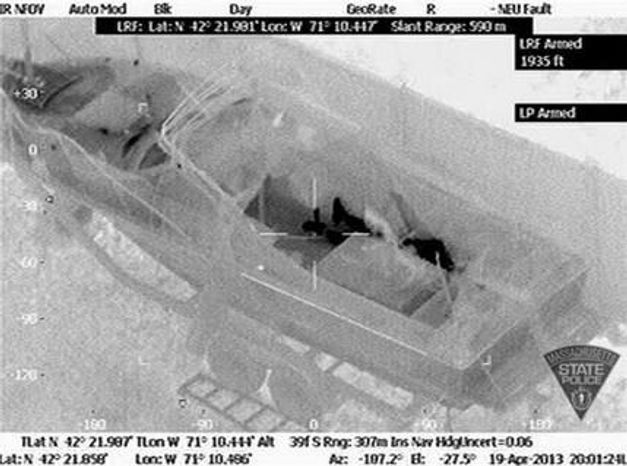 ** FILE ** This Friday, April 19, 2013, image made available by the Massachusetts State Police shows 19-year-old Boston Marathon bombing suspect, Dzhokhar Tsarnaev, hiding inside a boat during a search for him in Watertown, Mass. He was pulled, wounded and bloody, from the boat parked in the backyard of a home in the Greater Boston area. (AP Photo/Massachusetts State Police)