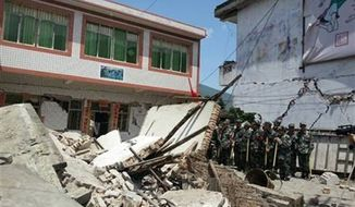 Buildings are destroyed by a powerful earthquake at Gucheng village of Longmen Township of Lushan County in Ya'an City, southwest China's Sichuan Province, Saturday, April 20, 2013, after a powerful earthquake. (AP Photo/Xinhua, Hai Mingwei) NO SALES