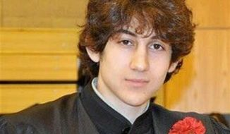 Dzhokhar Tsarnaev poses for a photo after graduating from Cambridge (Mass.) Rindge and Latin High School in this undated photo. (AP Photo/Robin Young)