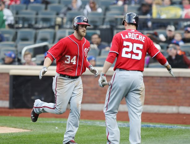 Outfielder Bryce Harper homered twice on Saturday to help lead the Washington Nationals over the New York Mets. (Associated Press photo)
