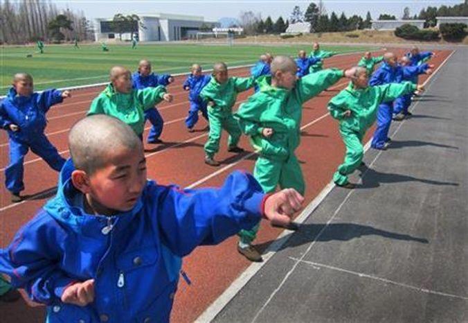 Eleven-year-old students at the Mangyongdae Revolutionary School, in Pyongyang, North Korea practice taekwondo, April 18, 2013. (AP Photo)