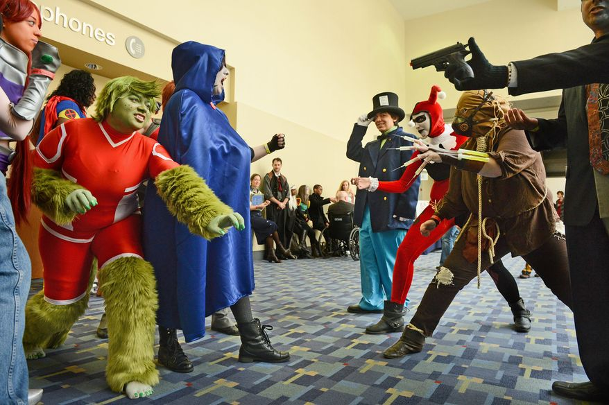 "Teen Titans and Young Justice characters (left) get into a playful argument with Batman villains while waiting for the costume contest to begin Sunday at Awesome Con D.C., a comic book convention at the Washington Convention Center. ""People forget this culture exists,"" Ariel Casey of Rockville said."