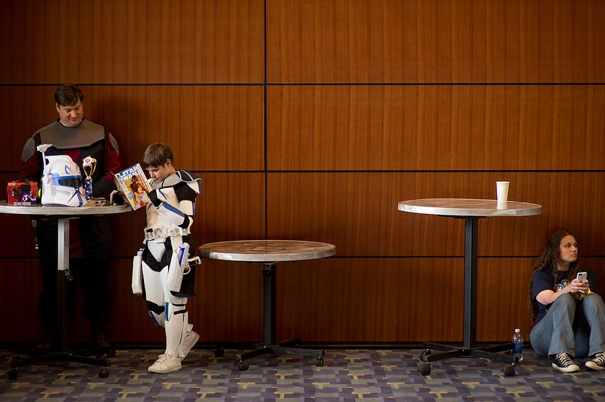 Justin Youtz of Woodbridge, Va., left, dressed as Anakin Skywalker reads comics with his son Tristin, 9, dressed as  Captain Rex from Star Wars at Awesome Con D.C., a comic book convention at the Washington Convention Center, Washington, D.C., Sunday, April 21, 2013. Tristin won 1st place in Awesome Con's Kid Costume Contest. (Andrew Harnik/The Washington Times)
