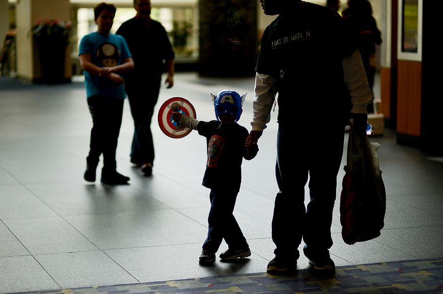 Eligah McNutt, 4, of South Riding, Va., center, dresses as Captain America at Awesome Con D.C., a comic book convention at the Washington Convention Center, Washington, D.C., Sunday, April 21, 2013. (Andrew Harnik/The Washington Times)