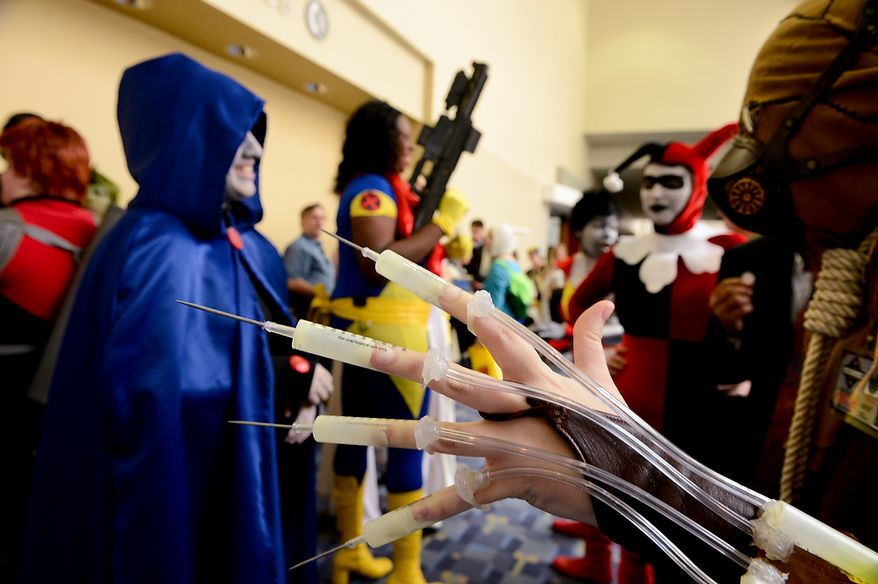 **FILE** Teen Titans and Young Justice characters (left) get into a playful argument with Batman villains while waiting for a costume contest to begin at Awesome Con D.C., a comic book convention at the Washington Convention Center, on April 21, 2013. (Andrew Harnik/The Washington Times)