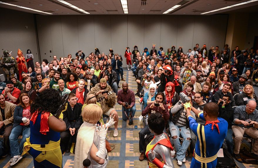 A group dressed as X-Men characters, bottom, pose for a packed audience during a costume contest at Awesome Con D.C., a comic book convention at the Washington Convention Center, Washington, D.C., Sunday, April 21, 2013. (Andrew Harnik/The Washington Times)