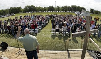 The Rev. John Crowder delivers a sermon during a service for the First Baptist Church held in a field on Sunday, April 21, 2013, four days after an explosion at a fertilizer plant in West, Texas. (AP Photo/Charlie Riedel)
