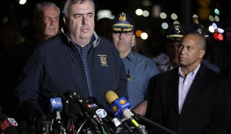 Boston police Commissioner Ed Davis (at podium), accompanied by Massachusetts State Police Col. Timothy Alben (second from right) and Gov. Deval Patrick (right), speaks during a news conference after the arrest of 19-year-old Dzhokhar Tsarnaev, a suspect of the Boston Marathon bombings, in Watertown, Mass., on Friday, April 19, 2013. (AP Photo/Matt Rourke)