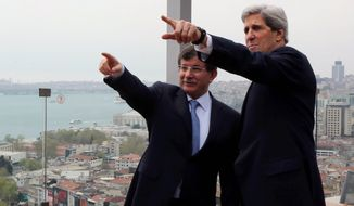 U.S. Secretary of State John F. Kerry (right) and Turkish Foreign Minister Ahmet Davutoglu point toward the Bosporus before a working lunch in Istanbul on Sunday, April 21, 2013. (AP Photo/Hakan Goktepe, Pool)