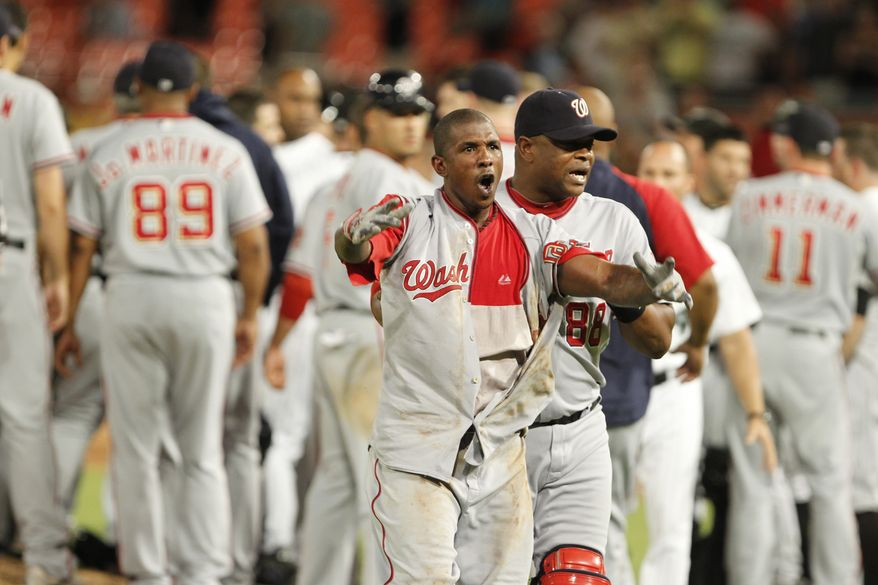 **FILE** Washington Nationals' Nyjer Morgan, center, is lead off the field after a brawl during the sixth inning of a baseball game against the Florida Marlins, Wednesday, Sept. 1, 2010 in Miami. (AP Photo/Wilfredo Lee)