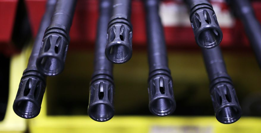 ** FILE ** The barrels of AR-15 rifles are pictured at Stag Arms in New Britain, Conn., on Wednesday, April 10, 2013. (AP Photo/Charles Krupa)